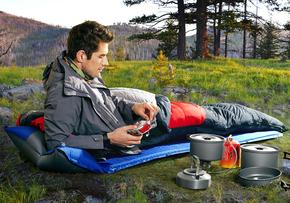 camping man lie on the sleeping bags